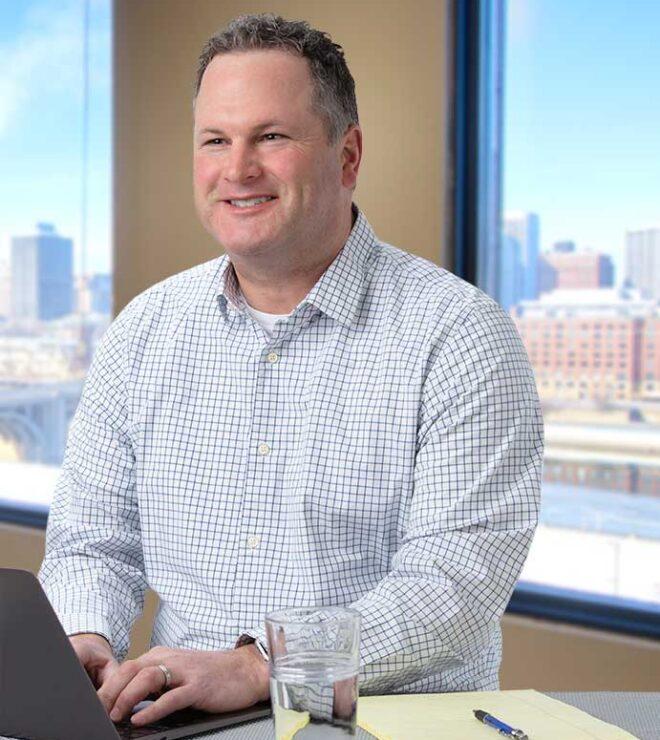 Craig Mulkay working at a computer