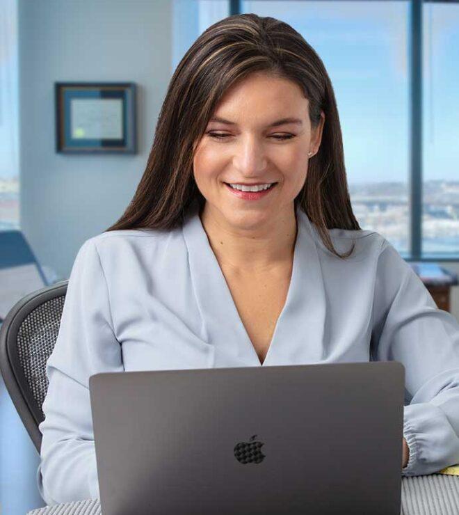 Jayme Shuda working at a laptop