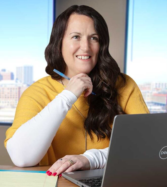 Kari Erickson working at a computer