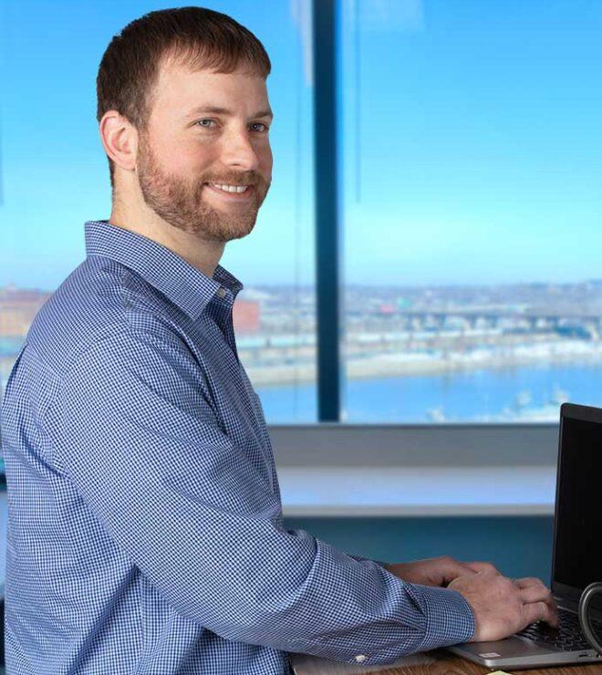 Trent Senske working at a desk