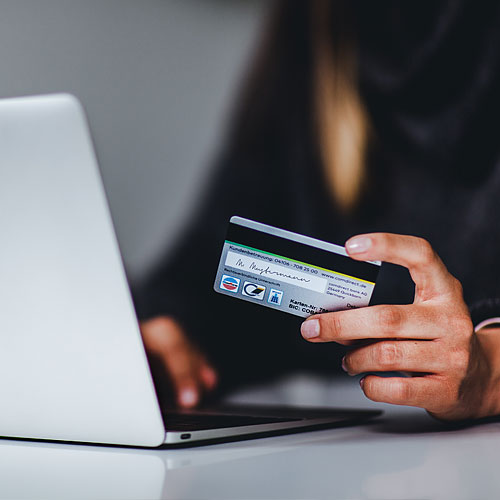 Woman completing credit card purchase on computer
