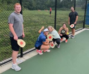 Mahoney employees playing pickle ball.
