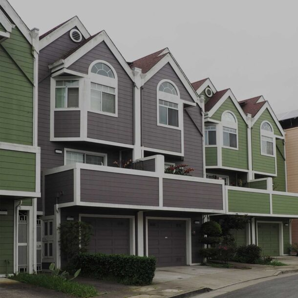 Row of different colored townhouses.